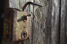 Old Antique Door Handle On Wooden Door. Black And White Photography