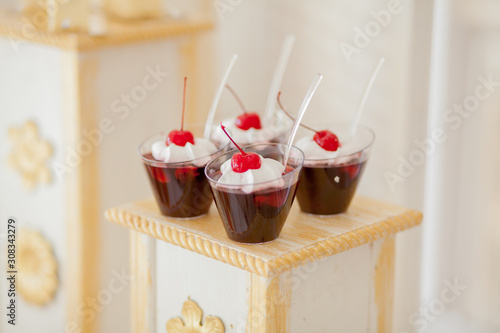 Cherry jelly in the glasses decorated with strawberry on andy bar Wallpaper Mural