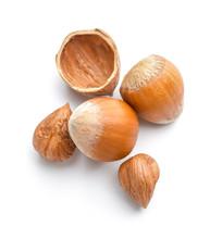 Tasty Hazelnuts On White Background