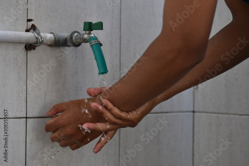 A moslem man take ablution, known as wudhu, as one of ritual purification to pra Fototapeta