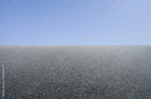 Empty asphalt floor with clean blue sky Wallpaper Mural