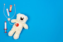 White Teddy Bear With Toy Stet...