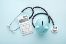 Health Insurance, Tax Concept On Blue Background