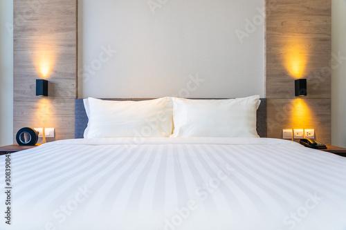 Fényképezés White comfortable pillow on bed decoration interior