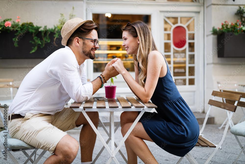 Fototapeta Happy romantic couple in love having fun outdoor in summer day