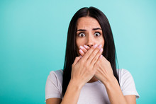 Close Up Portrait Of Crazy Mad Woman Feeling Guilty About Telling Secret Information Covering Her Mouth With Hands Isolated With Negative Emotions Teal Color Vibrant Background