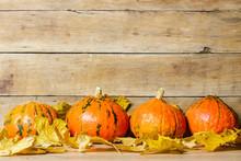 Pumpkins And Autumn Leaves On ...