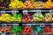 Fruits And Vegetables On Shelves In Supermarket