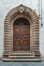 An Old Decorated Vintage Door In Historical Centre Of Florence, Italy