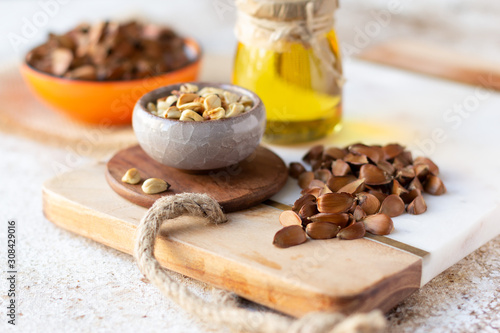 Beechnuts in shell, peeled and beech nut oil Wallpaper Mural