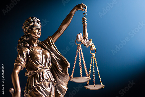 Bronze figurine of Lady Justice with her scales Canvas Print