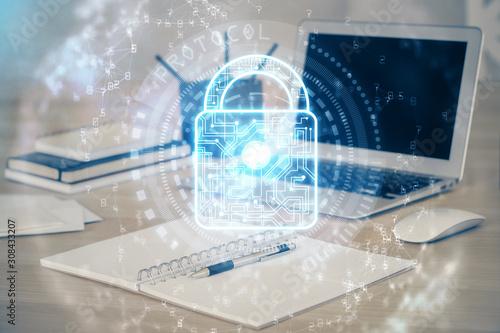 Fotografía Double exposure of desktop with computer and lock icon hologram