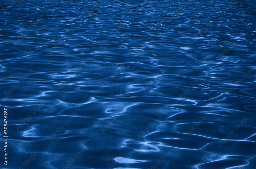 Fototapeta Water texture background representing the color of the year 2020 classic blue. Toned photo.