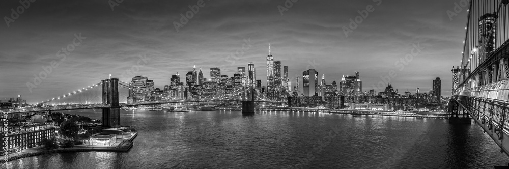 Fototapeta Brooklyn, Brooklyn park, Brooklyn Bridge, Janes Carousel and Lower Manhattan skyline at night seen from Manhattan bridge, New York city, USA. Black and white wide angle panoramic image.