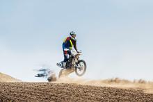 Motocross Rider Riding On Spor...