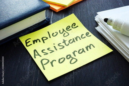 Employee assistance program EAP sign and pile of papers. Canvas Print