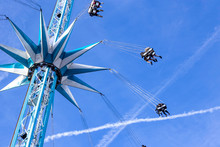 Chair Swing Ride Carnival Or Fairground Attraction Or Ride Against A Blue Sky
