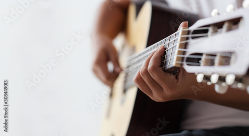 Leinwand Poster Woman hands playing acoustic classic guitar the musician of jazz and easy listen