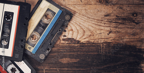 Tableau sur Toile Old audio tape compact cassette on wooden background