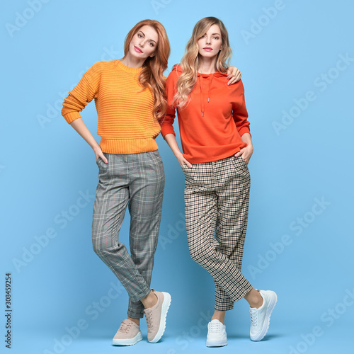 Two easy-going happy hipster Woman smiling, Stylish fashion orange colored outfit Tapéta, Fotótapéta