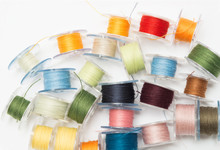 Colorful Bobbin Thread Isolated On White Background.