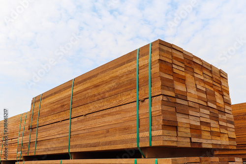 Obraz Pallet with a pile of lumber, packed for sale. - fototapety do salonu