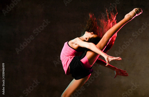 Fotomural Young slim athletic girl gymnast dancer jumping up stretching doing gymnastic ex