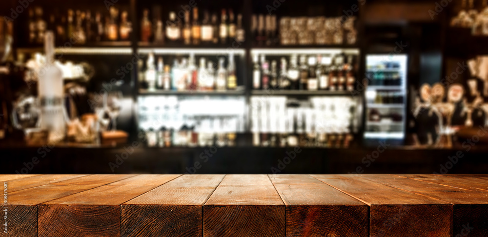 Fototapeta Wooden desk of bar and free space for your decoration.