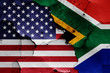 canvas print picture - flags of USA and South Africa painted on cracked wall