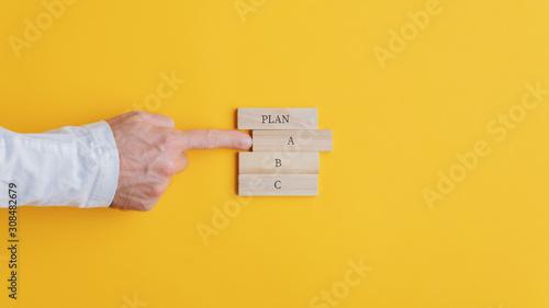 Hand of a businessman choosing a plan A option Canvas Print