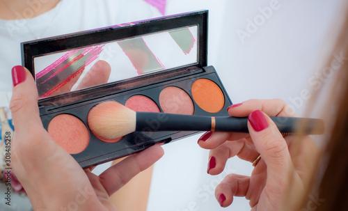 Photo Makeup professional artist applying powder blush