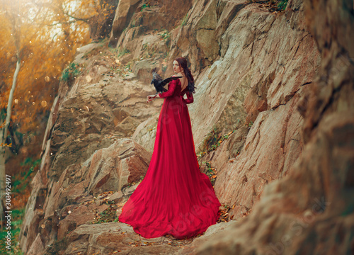 Obraz na plátně  Luxury sexy mysterious power brunette woman in red dress long train