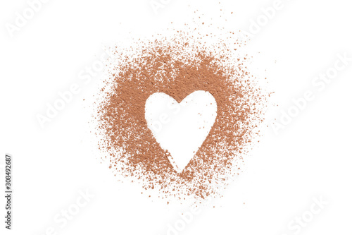 Heart made of cocoa powder isolated on white background Fototapet