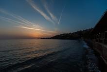 Sun Rising Over The Beach On A...