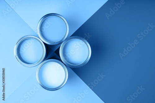 Four open cans of paint on bright symmetry background Fototapeta