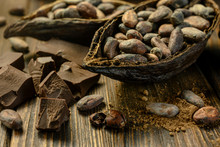 Open Cocoa Fruit Lies On Wooden Table