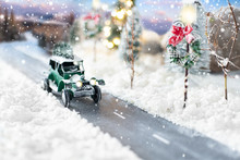 Miniature Classic Car Carrying A Christmas Tree On Winter Magic Background