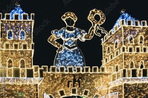 Obraz Illuminated castle with Christmas decorations on black background in Magdeburg, Germany - fototapety do salonu