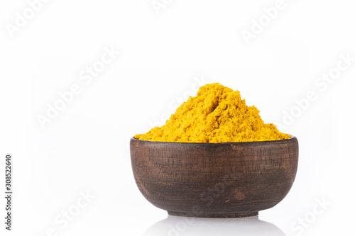 Valokuvatapetti Curry powder in a bowl - White background