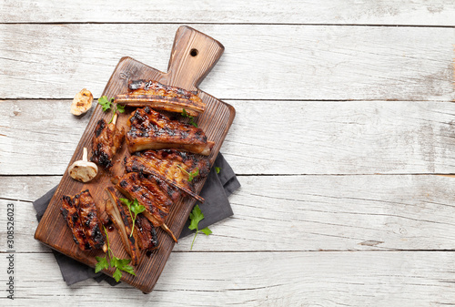 Fototapeta Barbecue beef ribs with bbq sauce sliced obraz