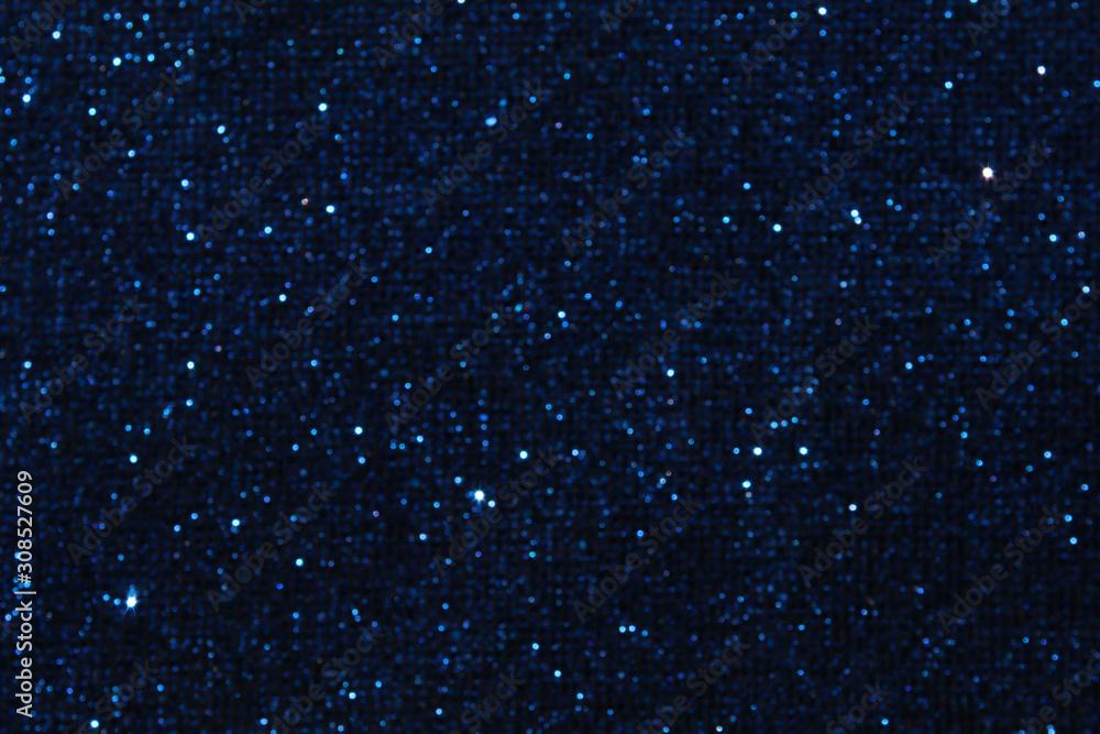 Fototapeta glitter classic blue lights background. de-focused. color of the year 2020