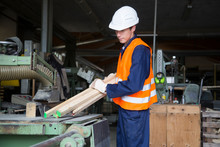 Young Worker At Carpentry Of Pallet Production