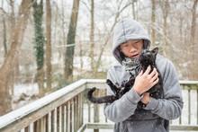 Asian Boy Lovingly Takes Curio...