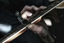 Close Up Of Old Hand Playing A...