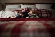 Toddler Boy Asleep On Red Plai...