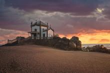 """""""Capela Do Senhor Da Pedra"""" At Sunset Over Atlantic Ocean"""