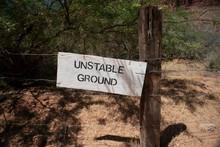Wooden Sign Warning Of Unstabl...