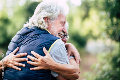 Old people senior cacuasian couple hug with love and friendship in outdoor leisu Canvas Print