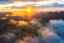 Aerial View Of Sun Rays At Sunset Lighting Up The Clouds Over Romsdalen Valley, Andalsnes, More Og Romsdal County