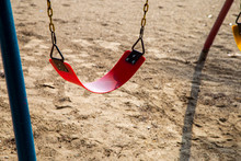 Swing On The Background Of Sand On A Sunny Day